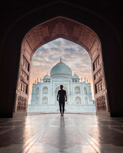 Silhouette Of Man Standing In Archway In Front Of Taj Mahal