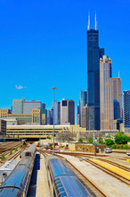 View Of The Railways Near The Union Station In Chicago With The Skyline In The Background.