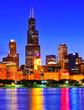 Leinwanddruck Bild - View of Chicago skyline from the shore of Lake Michigan at night.