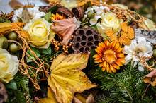 Autumnal Floral Decoration On Grave During All Saints Day In The Cemetery