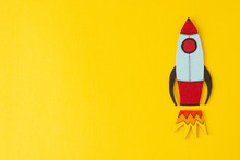 Start Up Business Concept. Boost Or Increase Incomes, Salary. Drawn Rocket On Colorful Yellow Background. Copy Space.
