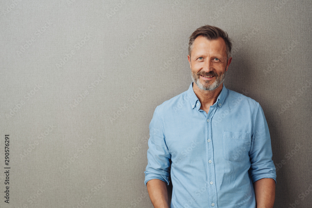 Fototapeta Relaxed attractive smiling middle-aged man