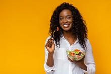 Happy African American Woman Eating Healthy Salad