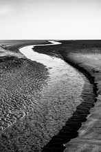 Grayscale Photography Of River And Open Field