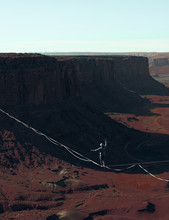 Person Walking On Wire Near Grand Canyon During Daytime