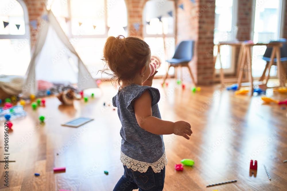 Fototapety, obrazy: Beautiful toddler standing drinking milk sucking baby bottle at kindergarten
