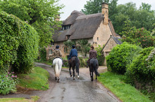 STANTON, ENGLAND - MAY, 26 2018:  Unidentifed People And Horses Near Cottages In The Village Of Stanton, Cotswolds District Of Gloucestershire.