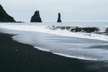 Famous Panorama Of The Black Sand Beach In Iceland. Dark Waves Of Atlantic Ocean Waves Covering The Sand