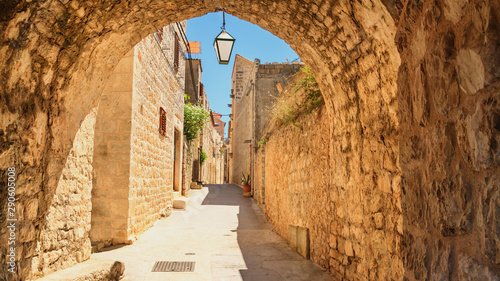Mediterranean summer cityscape - view of a medieval street in the Old Town of Hvar, on the island of Hvar, the Adriatic coast of Croatia
