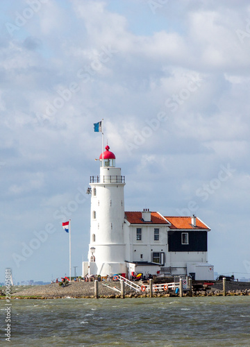 Photo Stands Horses Traditional lighthouse 'Het Paard van Marken' in Marken the Netherlands