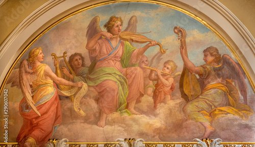 MENAGGIO, ITALY - MAY 8, 2015: The fresco of choir of angels wiht the music instruments in church chiesa di Santo Stefano by Luigi Tagliaferri (1841-1927).