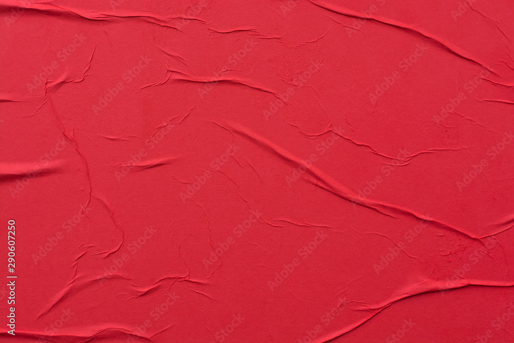 Fototapeta Red crumpled sheet of paper close-up.