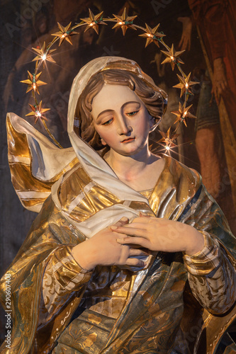 MENAGGIO, ITALY - MAY 8, 2015: The baroque carved polychroem statue of Immacolate in church Chiesa di Santa Marta.