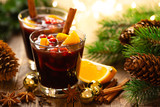 Christmas mulled red wine with spices, cranberry and oranges. Traditional hot drink or beverage, festive cocktail at Xmas or New Year with decorations