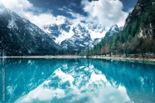 Printed kitchen splashbacks Mountains Mountain lake with perfect reflection at sunny day in autumn. Dolomites, Italy. Beautiful landscape with azure water, trees, snowy mountains in clouds, blue sky in fall. Snow covered rocks. Nature