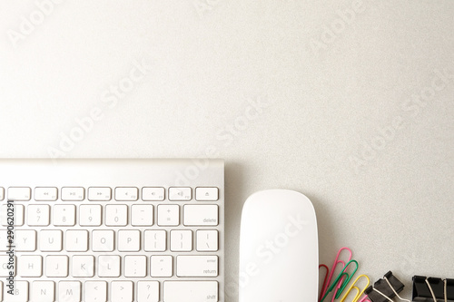 Top view of office stationeries over a grey background.