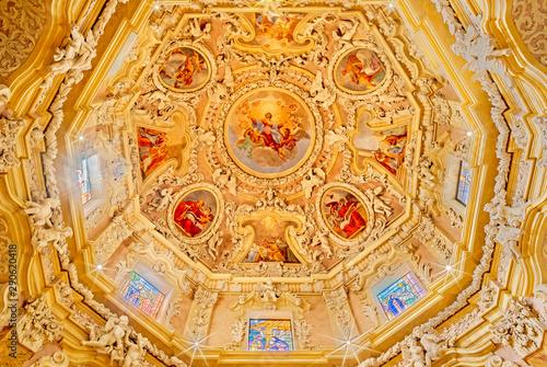 RIVA DEL GARDA, ITALY - JUNE 13, 2019: The ceiling fresco of Assumption of Virgin Mary in the cupola of church Chiesa di Santa Maria Assunta (Cappella del Suffragio) by Giuseppe Craffonara (19 cent.).