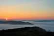 sunrise over mountains with fog in the valley