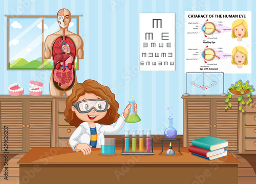 Young scientist in lab at school