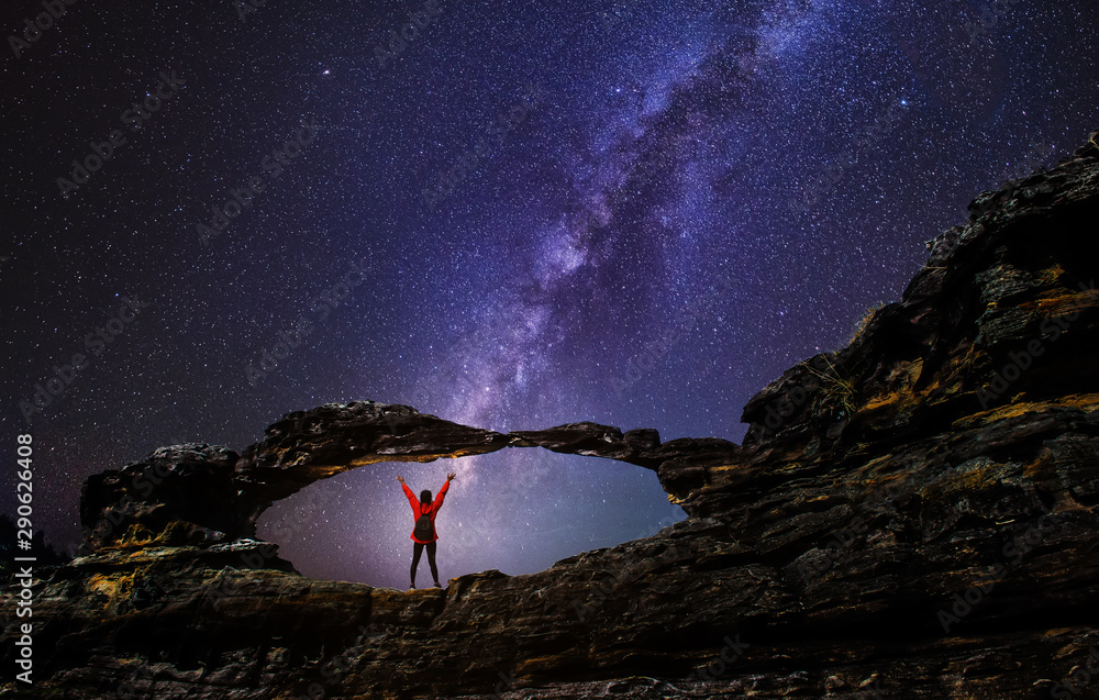 Fototapety, obrazy: Female hikers Happy on the rock at the beautiful milky way on the mountain in nature. Long exposure photograph, with grain.Image contain certain grain or noise and soft focus.