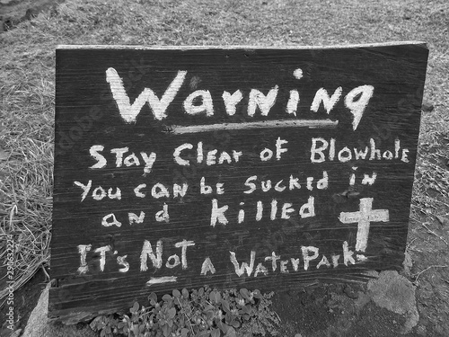 Fényképezés  Wooden sign with hand written message warning stay clear of blowhole you can be