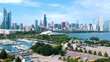 Chicago,IL/USA-September 18 2019: aerial drone footage of the city of Chicago downtown skyscraper landscape during high-noon. the sky's are clear blue as the building have a colorful vibrancy