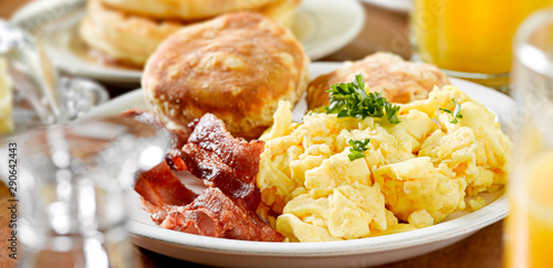 Fototapeta huge breakfast plate with scrambled eggs, bacon and biscuits