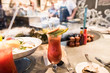 canvas print picture - a glass of Blood Mary served with oysters at a trendy cajun sea food restaurant in San Francisco