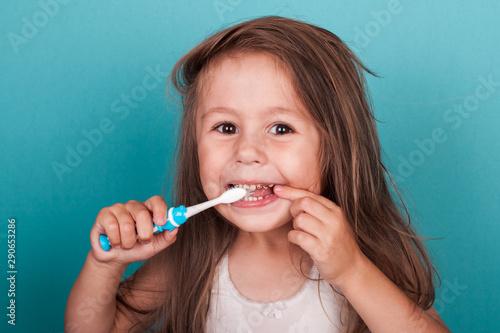 Obraz na plátně  Cute little girl brushing her teeth