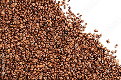 Keuken foto achterwand koffiebar Layer of isolated Roasted Coffee beans, white negative space in the top right corner