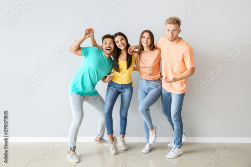 Fototapety, obrazy: Group of young people in stylish casual clothes near light wall