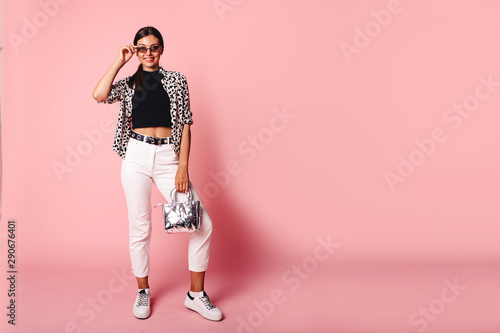Fototapety, obrazy: Fashion Model girl full length portrait isolated on pink background. Beauty stylish brunette woman posing in fashionable clothes in studio. Casual style, beauty accessories. High fashion urban style