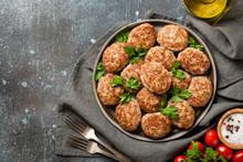 Homemade Meat Patties On Ceram...