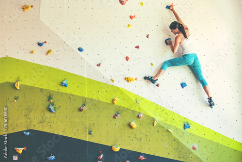 Woman in boulder gym. Canvas Print