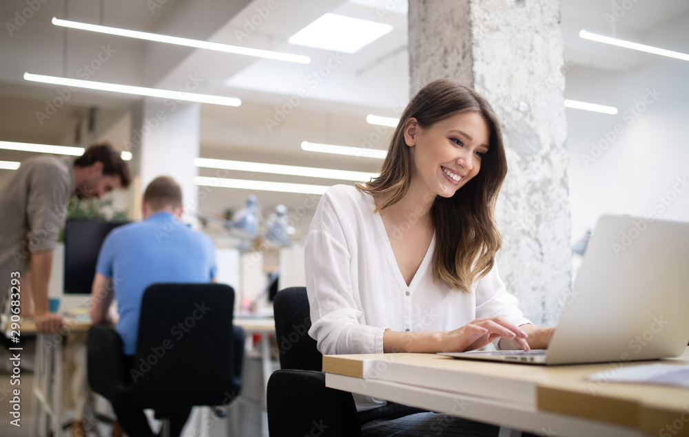 Fototapeta Young african american woman working with tablet in office
