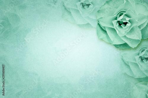 Rose flower on green paper background
