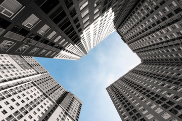 Looking up at condominium to sky in perspective view Architecture.