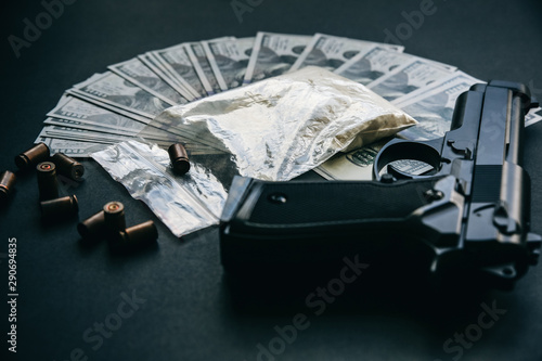 Photo Gun with bullets lying on the table
