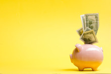Piggy Bank Isolated On Yellow Background. Savings Concept