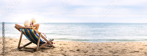 Fototapeta Young asia woman relaxing on beach chair with copy space obraz