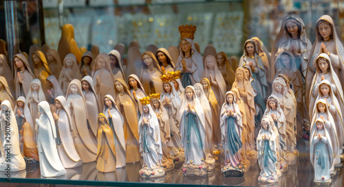 Obraz na płótnie statues or figurines in a shop, the commercial side of Lourdes.