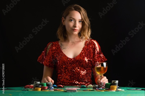 Girl plays poker in a casino in a club. Card game Canvas Print