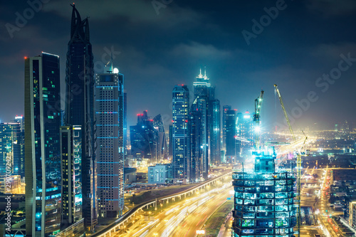 Downtown Dubai at night. Elevated view on highways and skyscrapers.