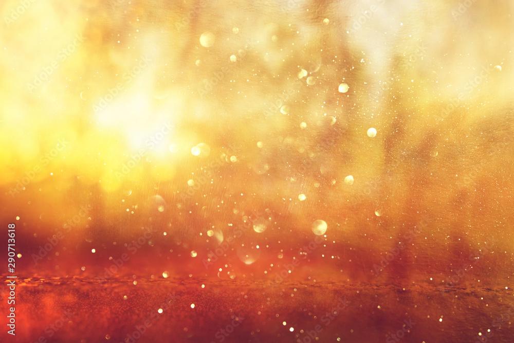 Fototapeta Abstract background of light burst among trees and glitter golden bokeh lights