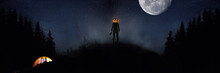 Halloween Theme: Scary Maniac With Pumpkin Head In Dark Forest On Sky Background With Midnight Moon. People In Camping Don't Know What The Danger. Horrible Fantasy. October, Horror Concept.