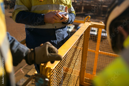 Canvas Print Miners worker looking at personnel risk assessment take five book before written