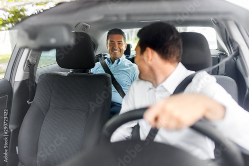 transportation, vehicle and people concept - middle aged male passenger talking Canvas-taulu