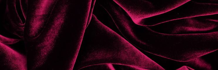 Long banner velvet texture dark red pink  color background, expensive luxury fabric,  wallpaper. copy space