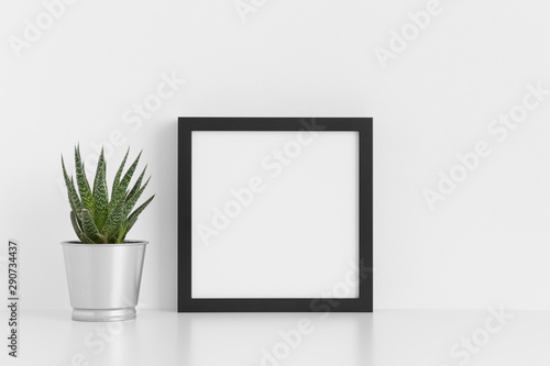 Fototapety, obrazy: Black square frame mockup with a cactus in a pot on a white table.
