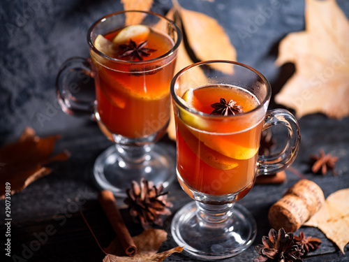 Recess Fitting Tea Two glasses of grog alcoholic drink or mulled wine on a dark table